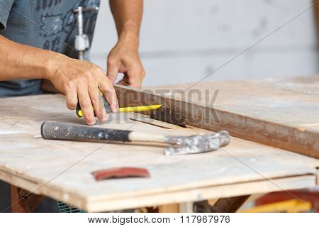 Carpenter Cut Wood For House Construction