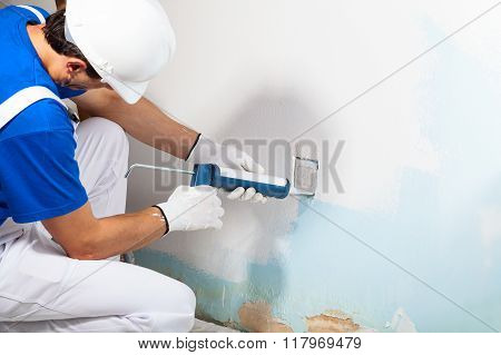 Close-up Of Professional Workman Applying Silicone Sealant With Caulking Gun on the Wall poster