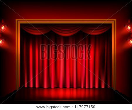 Theater stage with red curtains.