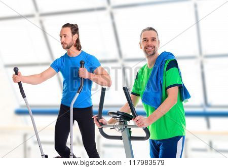 Two Young Man Train With Fitness Machine