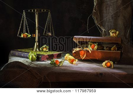 Physalis Fruits Escape From A Jewelery Box To A Brass Scale, Still Life Metaphor On A Rustic Wooden
