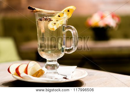 Apple Cider With Cinnamon Stick In A Glass