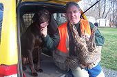 kevin and trapper after a day of pheasant hunting poster