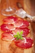 antipasti Platter of Cured Meat  jamon and wine, closeup poster