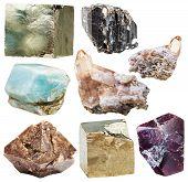 lot of natural mineral crystal gemstones - apatite zircon in rock garnet almandine pyrite schorl (black tourmaline) topaz stones isolated on white background poster