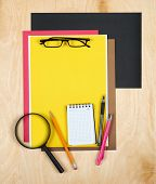 Flat lay office tools and supplies. Education background with stationery on wood. Flat design of creative office workspace, workplace. Top view of desk background. poster