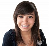 Cute Hispanic teenage girl smiling with braces on a white background poster