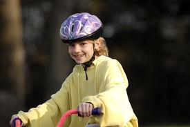 Girl Riding Her Bike 1