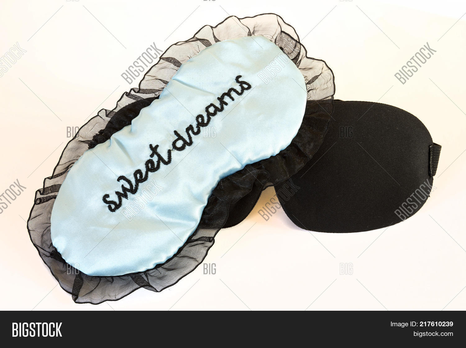 0cd1c9039ed Sleeping masks isolated on a white background. Sweet dreams blue and black.  Studio shot