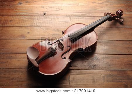 A Classic Violin on a Wooden Background