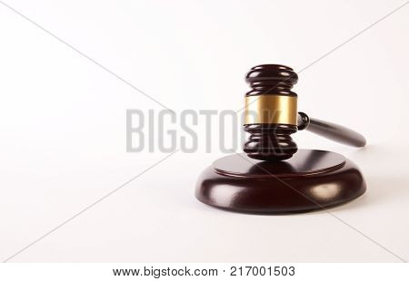 Judge gavel or law hammer and soundboard isolated on white background with copy space, close-up. Judgement or auction and conceptual of justice and judgements