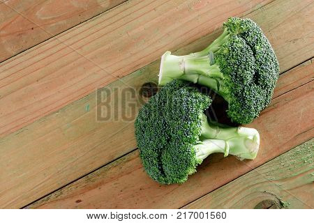 Two Fresh Broccoli on a Wooden Background