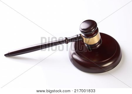Judge's Gavel over white background. Wooden judgement hammer or mallet isolated on white, close-up. Legal law legislation concept