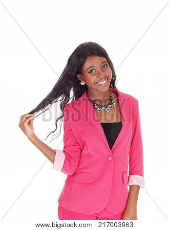 A close-up portrait image of a African American woman in a pink jacket and necklace smiling isolated for white background