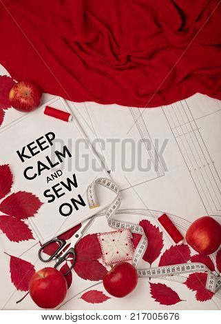 All for sewing - fabric patterns and sewing accessories. Fashionable autumn colors. Trend of the season - colors Grenadine and Flame scarlet. Flat lay concept.