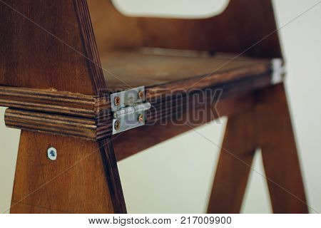 stained wooden staircase staircase wooden staircase on white background in studio with depth of field. metal fasteners and loops