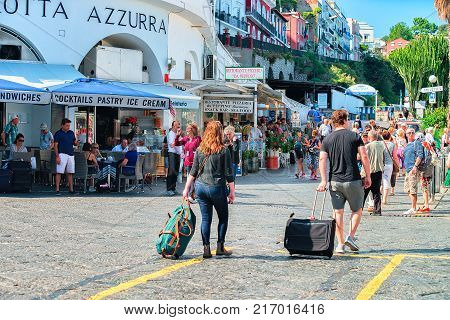 Capri Italy - October 3 2017: Tourists with luggage bags on Capri Island Italy