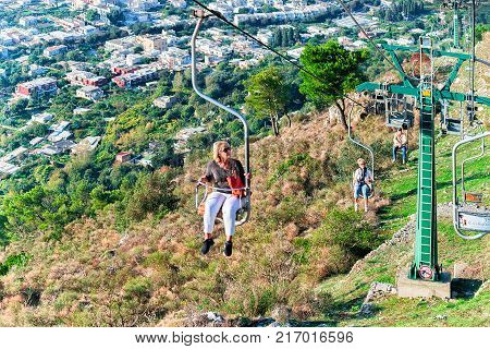 Capri Italy - October 3 2017: People on funicular cale chair over Capri Island Italy. Selective focus. Focus in motion