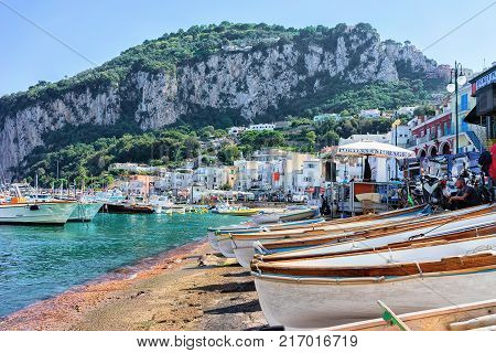 Capri Italy - October 3 2017: Boats at Marina Grande embankment of Capri Island in Tyrrhenian sea Italy
