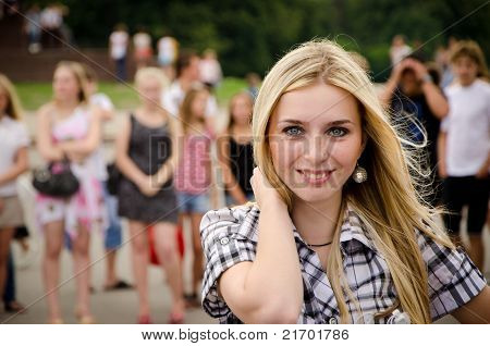 Street portrait of a beautiful blond girl with grey eyes.