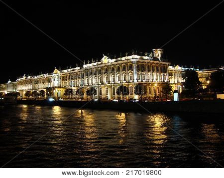 museum reflects in Neva river. Winter Palace building, St. Petersburg, Russia