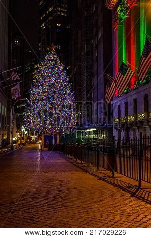 NEW YORK-DECEMBER 05: The nicely decorated Wall St Christmas tree as seen before dawn on December 5 2017 in lower Manhattan.