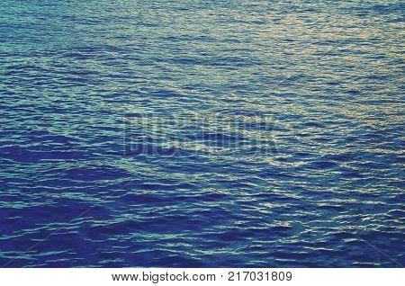 Ocean water texture background.Ocean water surface.Blue ocean.Sea water texture pattern.Filtered,soft focus.
