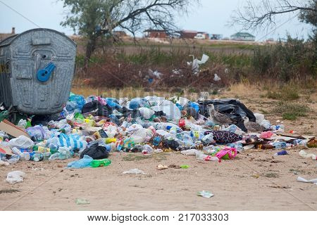 14 august 2017 Arabat Arrow in ukrainian part of Crimea. Seagulls feed on a garbage dump. Waste is ou of garbage can. Symbol of bad environmental situation.