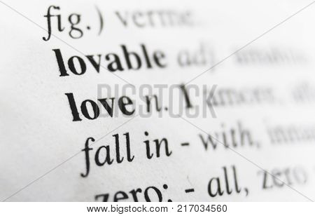 The definition of Love. Love word from dictionary close up. Photo stock.
