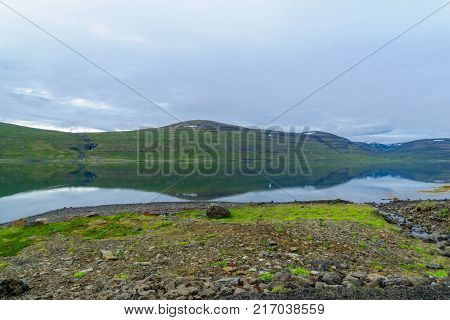 View of coastline and landscape along the Isafjordur fjord in the west fjords region Iceland