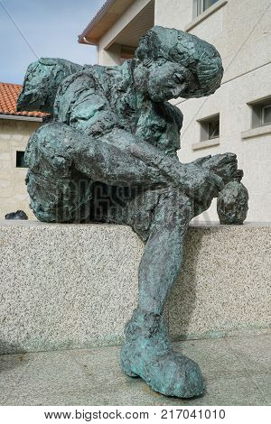 VALGA, SPAIN - SEPTEMBER 10, 2017: Pilgrim memorial in front of the pilgrim hostel of Valga on the Camino de Santiago trail on September 10, 2017 in Galicia, Spain