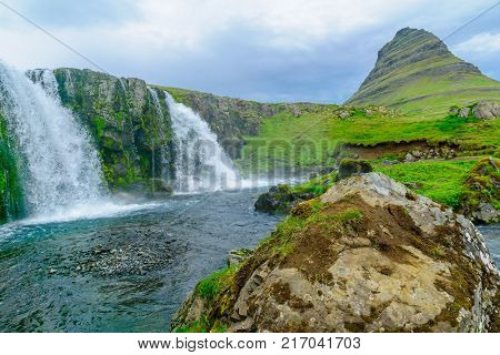 View of the Kirkjufell mountain (Church mountain) and the Kirkjufellsfoss waterfalls in the Snaefellsnes peninsula west Iceland poster