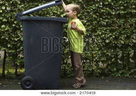 Boy Trashing A Can