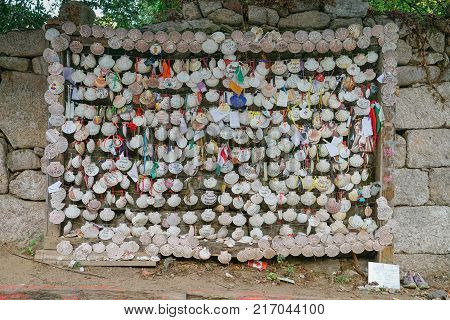 ARCADE, SPAIN - SEPTEMBER 8, 2017: Place were pilgrims left their pilgrim scallops with hopes and wishes, Camino de Santiago trail on September 8, 2017, in Spain