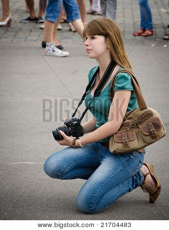 Beautiful photographer girl at the kissing day in Kharkov, Ukraine. July 6 2011.