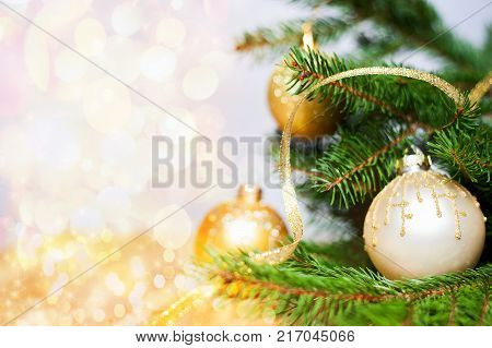 christmas ball on tree with copy space and glittering background