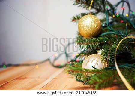 Christmas and New Year Decoration. Baubles hanging on Christmas Tree. Xmas holiday background with garlands, tinsel, ball