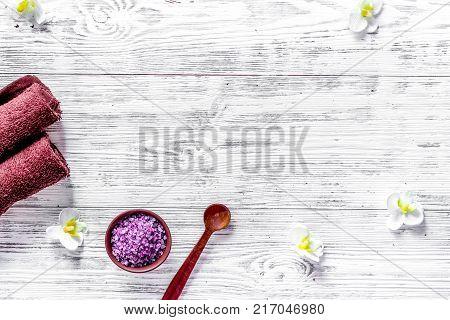 Lavender bath salt on wooden background top view.