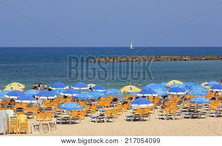 TEL AVIV, ISRAEL - August 24, 2016: chaise lounges and umbrellas on the city beach Tel Aviv on august 24, 2016 Tel Aviv-Yafo, Israel