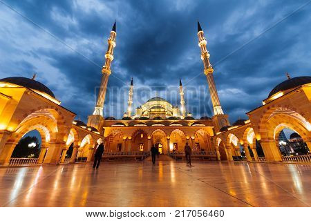 the majestic Moslem mosque glows, under the night sky