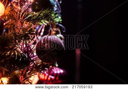 Christmas Toy On The Christmas Tree. New Year Ornaments Winter Background For Postcard Empty Space.