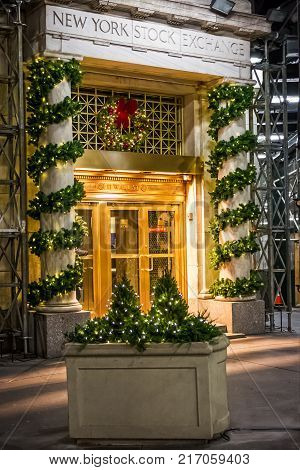 NEW YORK-DECEMBER 05: Christmas decorations and lights adorn the entrance to the New York Stock Exchange on December 5 2017 in lower Manhattan.