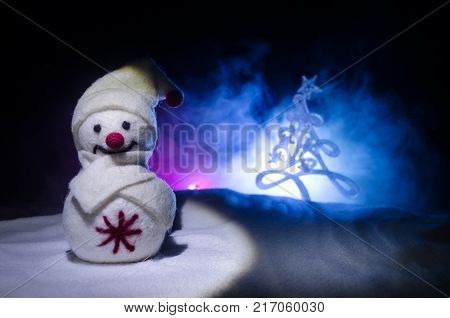 New Year. The Snowman Unloads Gifts For The New Year. White Snowman Surrounded By Christmas Trees On