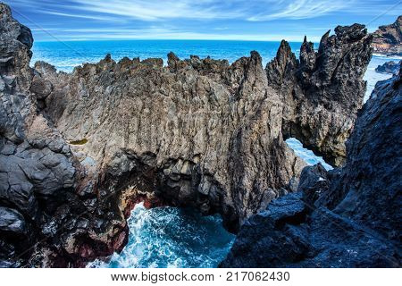 Magic travel on the fantastic island of Madeira. Rocks, bays and grottoes at coast of Atlantic. Concept of exotic and ecological tourism