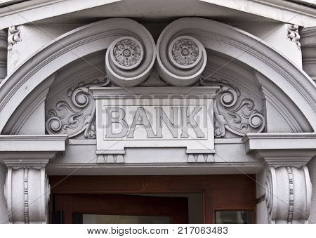 Entrance to bank, Illistation of any bank and antique architecture.