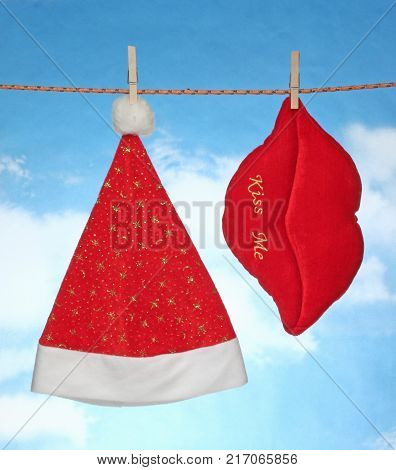 happy Merry X mas Hanging christmas decoration hart and santa hat.