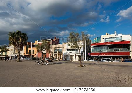 PORTIXOL, MALLORCA, BALEARIC ISLANDS, SPAIN - SEPTEMBER 27, 2017: People out and about along the promenade on a sunny day on September 27, 2017 in Portixol, Mallorca, Balearic islands, Spain.