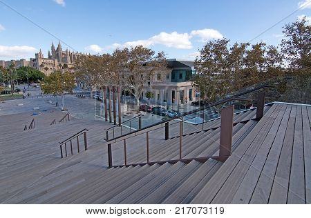 MALLORCA, BALEARIC ISLANDS, SPAIN - NOVEMBER 8, 2017: Cathedral from stairs on Moll Vell on a sunny day in Palma de Mallorca on November 8, 2017 in Mallorca, Balearic islands, Spain.
