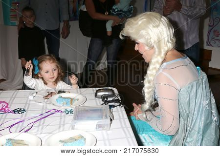 LOS ANGELES - NOV 26:  Amelie Bailey, Elsa Impersonator at the Amelie Bailey 2nd Birthday Party at Private Residence on November 26, 2017 in Studio City, CA