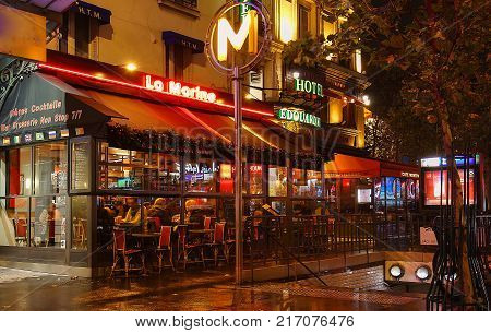 Paris, France -December 03, 2017: Typical Parisian cafe La Marine decorated for Christmas in the heart of Paris. Christmas is one of the main Catholic holidays, which is celebrated on a large scale throughout